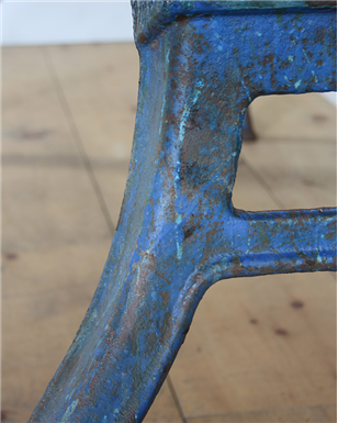 large holed blue legged table